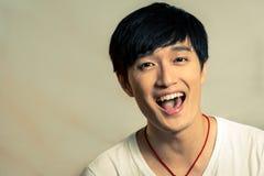 Jonge mens het lachen Stock Afbeelding
