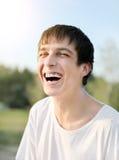 Jonge mens het lachen stock foto's