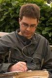 Jonge mens het schrijven Royalty-vrije Stock Fotografie