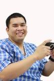 Jonge mens het spelen met spelen van een de draagbare video stock afbeelding