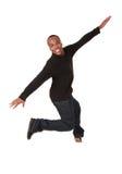 Jonge mens het springen van vreugde royalty-vrije stock afbeeldingen