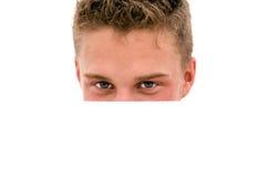 Jonge mens het verbergen Stock Foto's