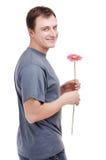Jonge mens met bloem in handen Royalty-vrije Stock Fotografie