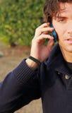 Jonge mens met celtelefoon Royalty-vrije Stock Afbeelding
