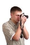 Jonge mens met een camera Royalty-vrije Stock Afbeeldingen