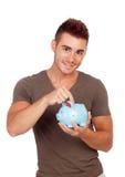 Jonge mens met een spaarpot Royalty-vrije Stock Foto's