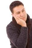 Jonge mens met een tandpijn Stock Foto's
