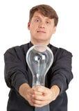 Jonge mens met elektrische bol in handen Stock Fotografie
