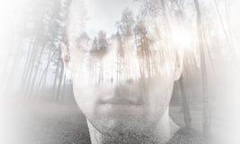 Jonge mens met gesloten die ogen met landschap worden gecombineerd royalty-vrije stock afbeelding
