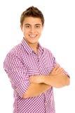 Jonge mens met gevouwen wapens Stock Foto