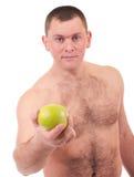 Jonge mens met groene appel stock foto