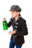 Jonge mens met groene fles royalty-vrije stock foto