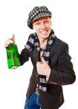 Jonge mens met groene fles royalty-vrije stock afbeeldingen