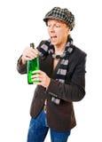 Jonge mens met groene fles stock foto's