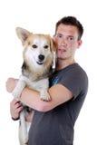Jonge mens met hond royalty-vrije stock foto