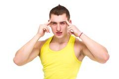 Jonge mens met hoofdpijn Royalty-vrije Stock Afbeeldingen