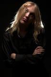Jonge mens met lang blond haar stock afbeeldingen