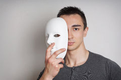 Jonge mens met masker Stock Foto