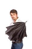 Jonge mens met paraplu stock afbeelding