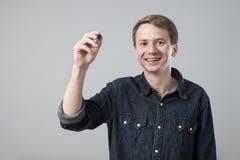 Jonge mens met pen Stock Foto