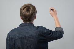 Jonge mens met pen Stock Afbeeldingen