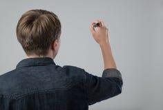 Jonge mens met pen Royalty-vrije Stock Foto's