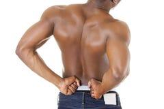Jonge mens met rugpijn Stock Afbeeldingen