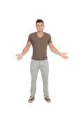Jonge mens met twijfelachtige uitdrukking Stock Fotografie
