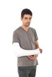 Jonge mens met verwond wapen royalty-vrije stock afbeeldingen