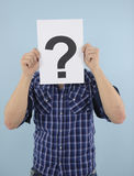 Jonge mens met vraagteken Royalty-vrije Stock Foto