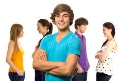 Jonge mens met vrienden Royalty-vrije Stock Afbeeldingen