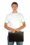 Jonge mens met zwart plastic geval op wit Stock Afbeelding