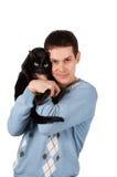 Jonge mens met zwarte kat Royalty-vrije Stock Afbeelding