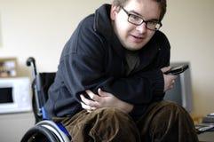 Jonge mens op rolstoel Royalty-vrije Stock Foto