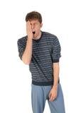 Jonge mens in pyjama's Royalty-vrije Stock Afbeeldingen