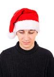 Jonge mens in santahoed Stock Afbeeldingen