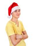 Jonge mens in santahoed Royalty-vrije Stock Afbeeldingen