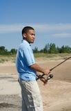 Jonge mens visserij Royalty-vrije Stock Afbeeldingen