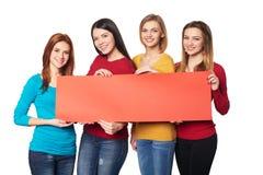 Jonge mensen met banner Stock Foto