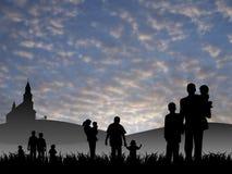Jonge mensen met kinderen die naar kerk gaan Stock Foto