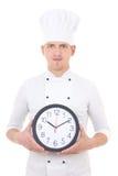 Jonge mensenchef-kok in de eenvormige klok van het holdingsbureau die op wit wordt geïsoleerd Royalty-vrije Stock Foto