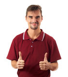 Jonge mensenduim omhoog en glimlachen geïsoleerdj op wit Stock Afbeeldingen