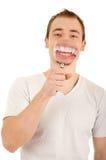 Jonge mensenglimlach door lens Stock Afbeeldingen