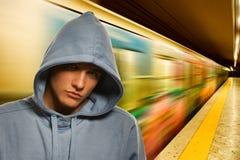Jonge misdadiger in metro royalty-vrije stock afbeeldingen