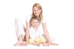 Jonge moeder en haar baby Stock Foto