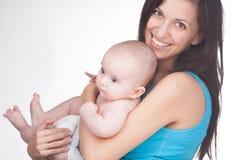 Jonge moeder met baby Stock Foto