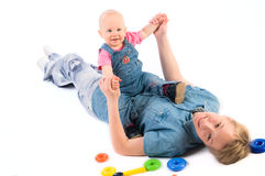Jonge moeder met babymeisje Stock Afbeeldingen