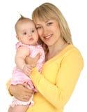 Jonge moeder met babymeisje Royalty-vrije Stock Afbeeldingen