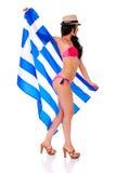 Jonge mooie donkerbruine vrouw in bikini en bonnet die La houden royalty-vrije stock foto