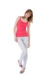 Jonge mooie tiener op jeans over wit stock foto